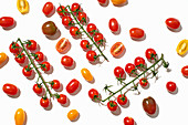 Healthy colorful cherry tomatoes on white background