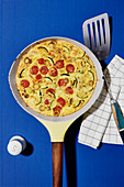 Vegetable frittata with tomatoes and courgettes