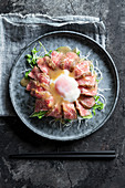 Miyabi wagyu tataki with julienned daikon radish, poached egg and ponzu sauce