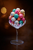 Colourful chocolate pralines in a stemmed glass