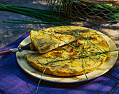 Courgette quiche with cheese and chives