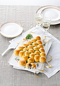 Bread rolls filled with mozzarella and truffels in the shape of a tree