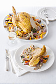 Stuffed capon on a bed of vegetables