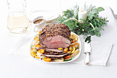 Roast beef with a five-pepper crust and citrus sauce