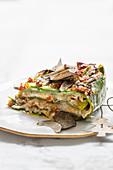Green lasagne with guinea fowl ragout and truffle Bechamel sauce