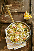 Green tagliatelle with salmon and cheese sauce