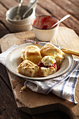 Camp oven lemonade scones with jam and cream