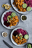 Spicy chicken curry with banana chips and red beet quinoa