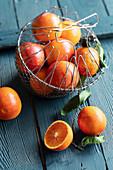 Blood oranges in a wire basket