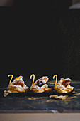 Choux pastry swans with white russian cream