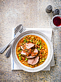 Roast lamb rump with flageolet and spring vegetable ragout