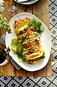 Salmon tacos with coriander and spring onion