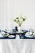 Table set in blue and white with spring flowers