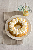 Courgette cake with lemon sauce and whipped cream