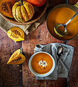 Pumpkin and squash soup with yoghurt and chilli flakes