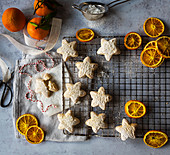 Shortbread Star biscuits with icing sugar and orange slices