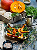 Roasted pumpkin with herbs and kale