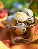 Boiled quail's eggs in a glass