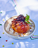 A roasted peach with rice pudding and caramel sauce