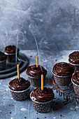 Chocolate muffins with blown candles