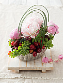 DIY flower baskets with peonies, cherries and echeveria