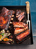 Pork ribs with apple juice glaze and grilled vegetables