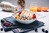 Vegan porridge with fresh fruits and orange juice