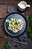 Vegan ravioli with spinach filling on parsnip and cashew sauce