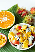 Exotic fruit salad with dragon fruit, mango and passion fruit
