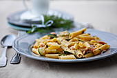 Penne with salmon and zucchini
