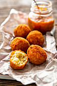 Baked rice balls (arancini) with tomato sauce