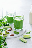 Spinach, kale and cucumber smoothie with kiwi and almond milk