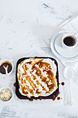 Coffee cake with whipped cream and caramel sauce