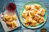 Baked dumplimgs with pate and cranberry jam