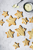 Chai Spiced Star Tea Biscuits With White Chocolate Drizzle