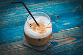 Iced latte on a blue wooden table