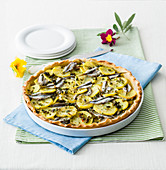 Potato and anchovy tart with fresh herbs