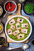 Ham rolls with egg and horserdish dip in aspic with green peas