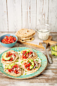 Home made tortillas with shredded cooked chicken, avocao and tomato salsa