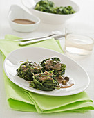 Agretti nests with anchovy and caper sauce