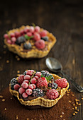 Chocolate cream with frozen berries in a waffle bowl
