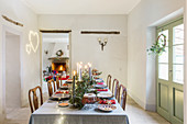 Festively set Christmas table in country house