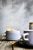 Cinnamon latte with spices and a glazed pear slice in a cup