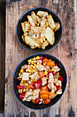 Chicken and vegetable dishes with fried potatoes