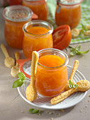 Tomato soup in glasses served with puff pastry spoons