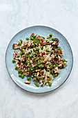 Millet salad with peas, dates and almonds