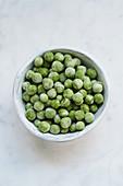 Frozen peas in a ceramic bowl