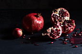 Still life with pomegranates broken open