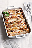 Gratin crepe rolls with guinea fowl and mushroom ragout