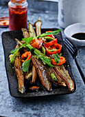 Fried eggplants with pointed peppers, spring onions and soy sauce (Japan)